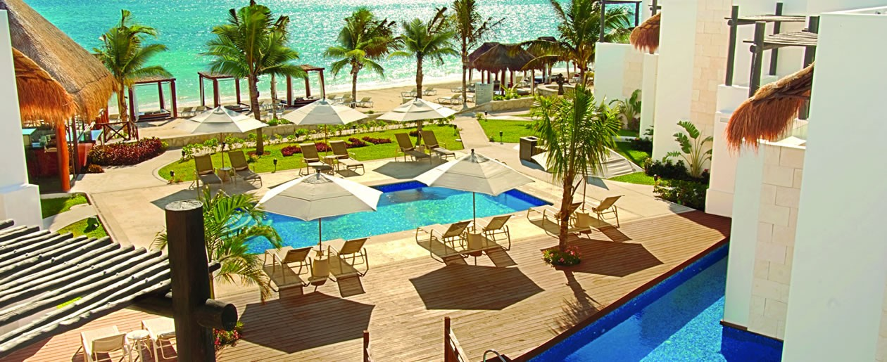Caribbean turquoise waters and incredible resort grounds combines for a beautiful pool side destination wedding.