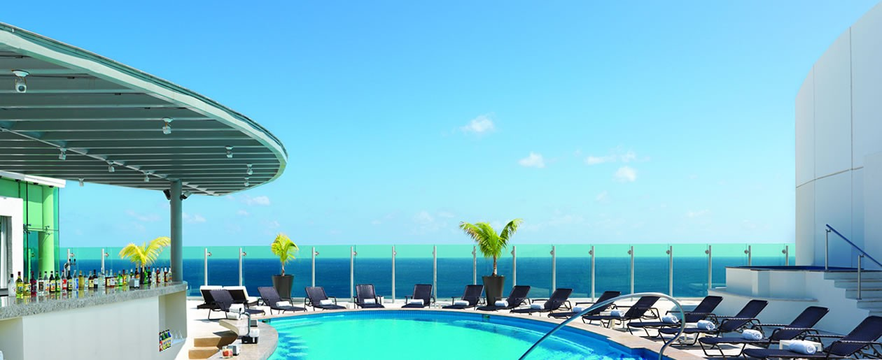 Breathtaking views atop the sky pool with swim-up bar.