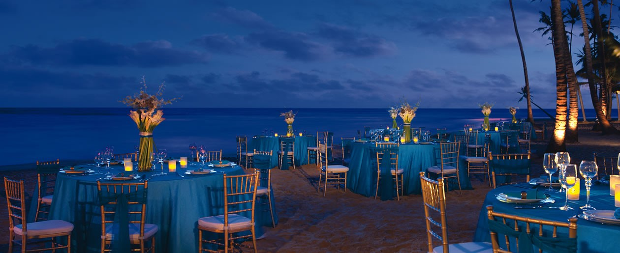 A gorgeous nighttime beach ceremony set-up shot at Dreams Punta Cana beach.