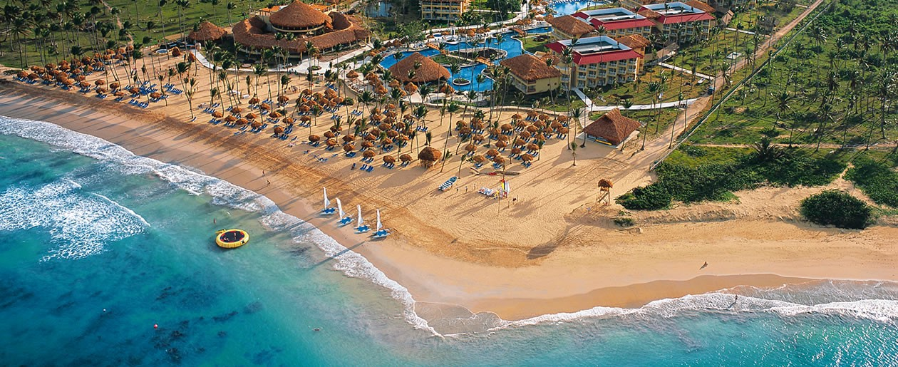 Aerial view of Dreams Punta Cana featuring the crystal clear Caribbean Sea and sandy-white beach.