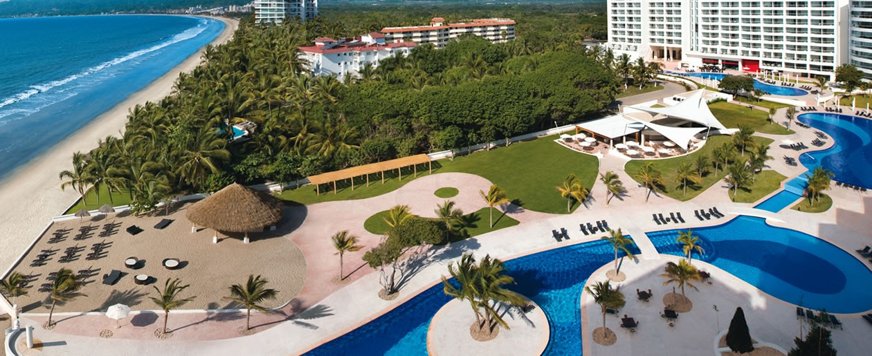 An aerial view of Dreams Villamagna Nuevo Vallarta featuring a dual temperate pool and exquisite ocean views.