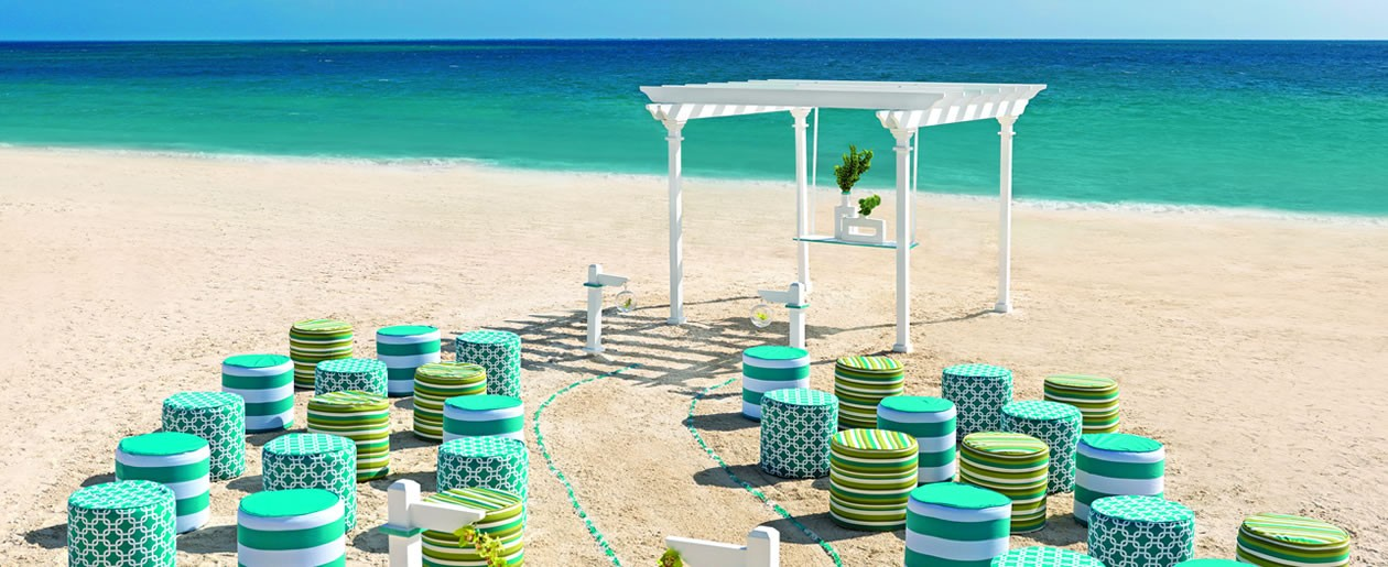 Celebrate the beach-side setting with Colin Cowie's Seaglass collection, a geometric panorama of aqua, green, and white.