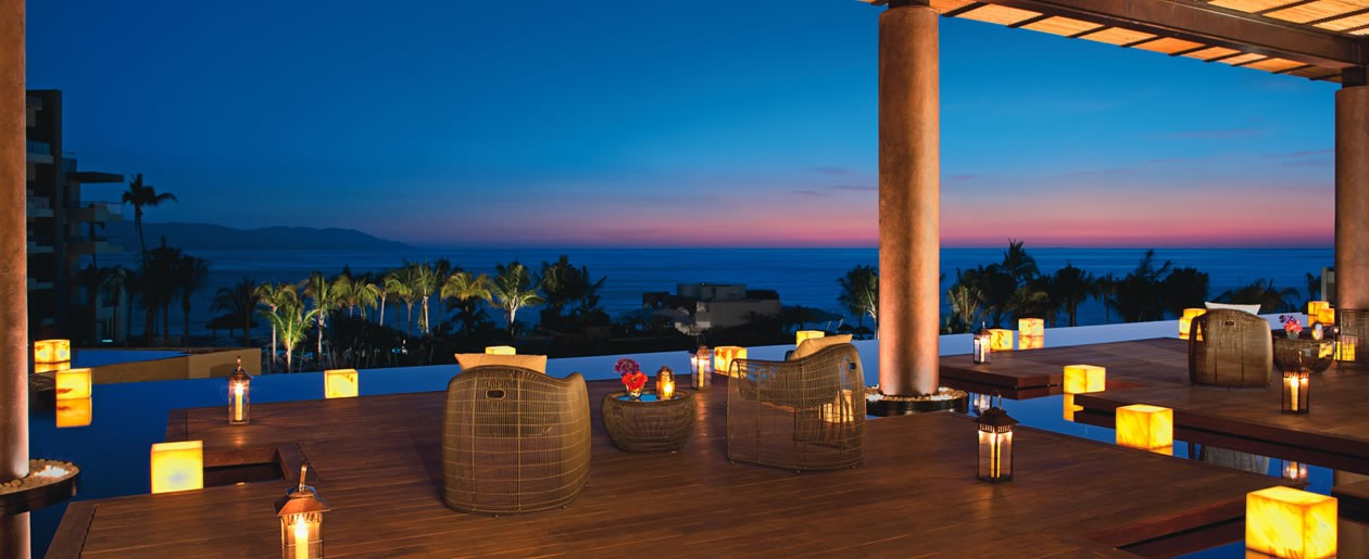 The lobby's terrace offers a comfortable place to enjoy the sunset.