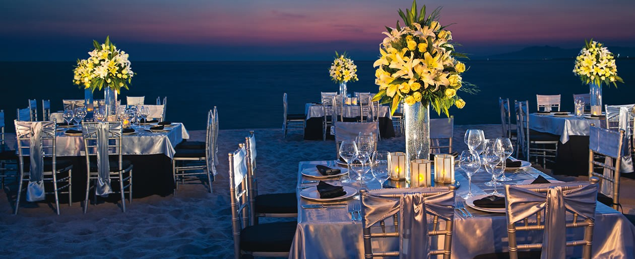 Elegant wedding set up with colorful sunset as the backdrop.