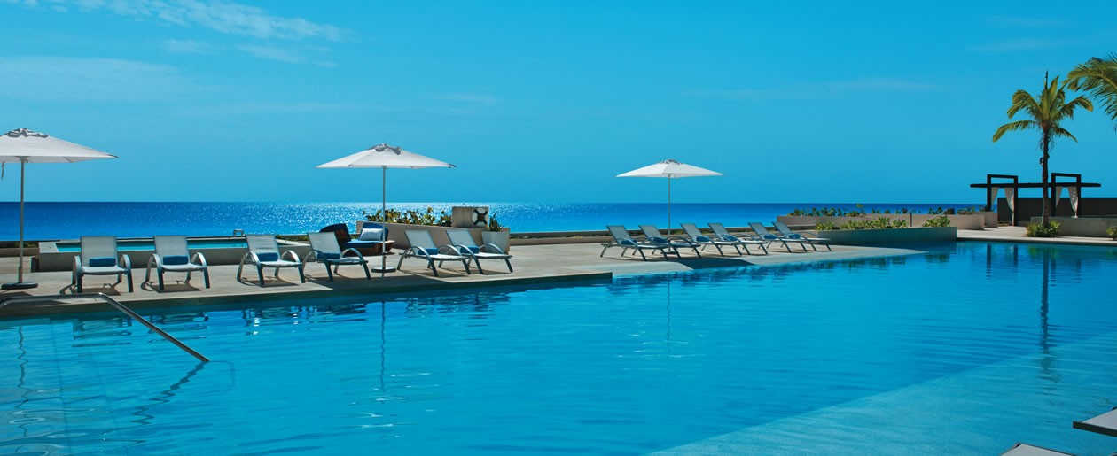 Relax by the Jacuzzi or one of the swimming pools overlooking the crystal-clear Caribbean Sea.