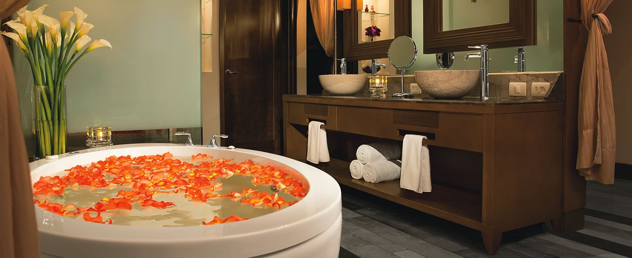In the bathroom of a Junior Suite is a relaxing whirlpool bathtub and a double vanity set-up.