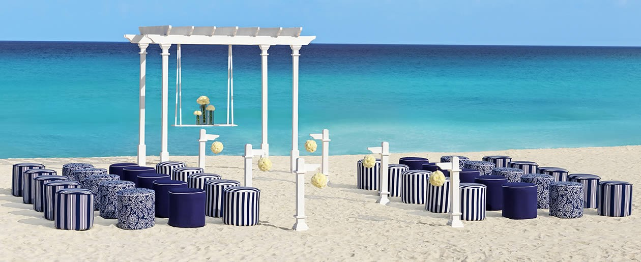 The Palace Resorts Nautical beach wedding package.