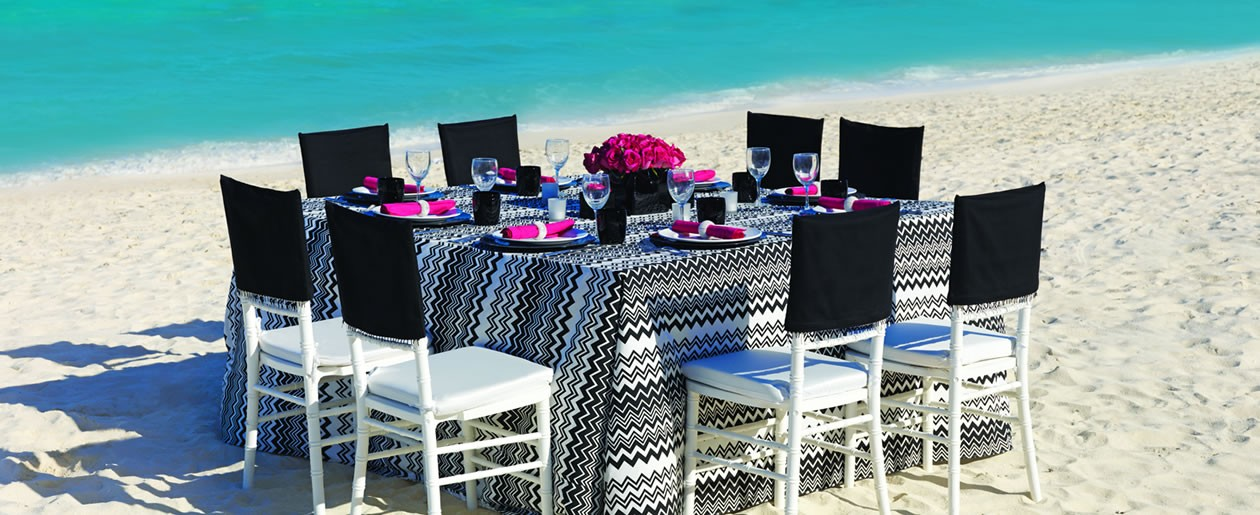 The Rocker Chic Colin Cowie table set-up on the beach.