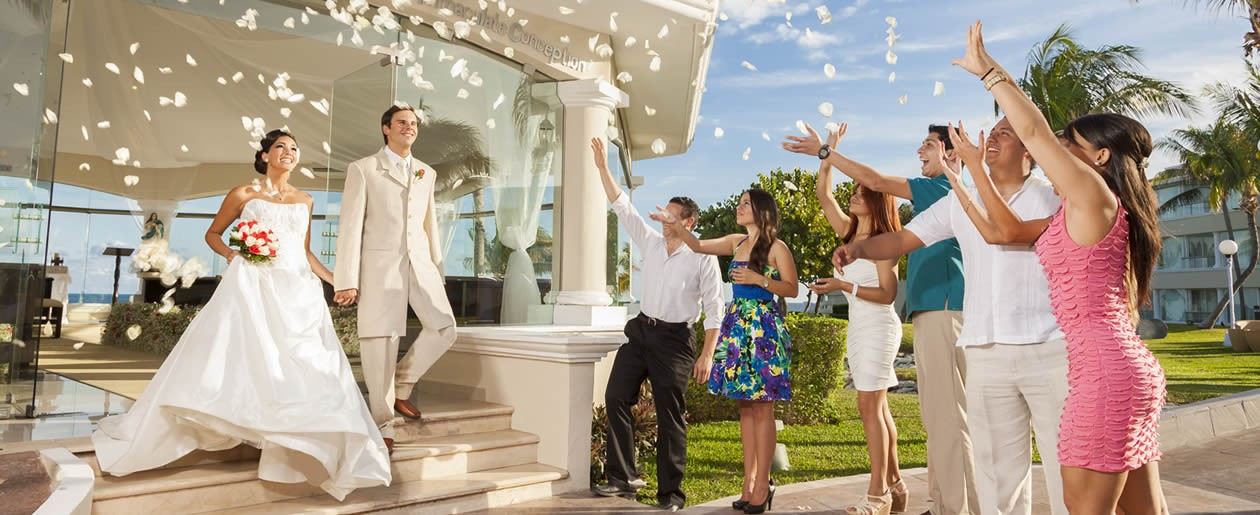 Exchange marriage vows in a traditional Catholic wedding at the Moon Palace resort.