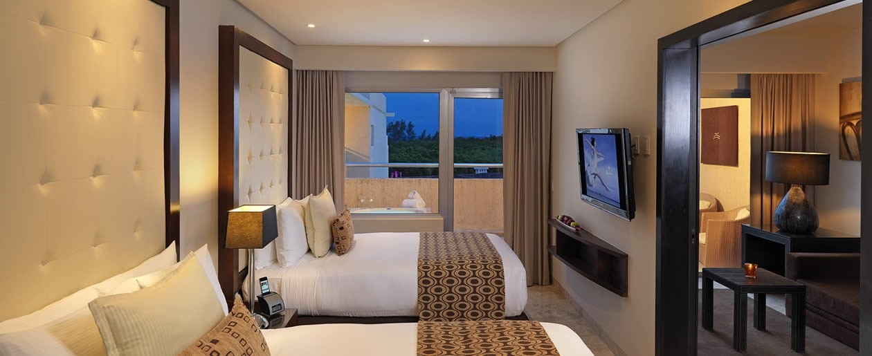 Families will enjoy modern luxury accommodations in Playa del Carmen.