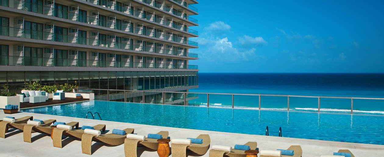 Defining elegance, the AAA Four Diamond Secrets The Vine Cancun is bordered by the cerulean waters of the Caribbean and white sand beaches in stunning Cancun.